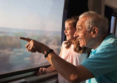 Senior Traveling with Family on a Train